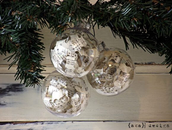 Transparent Christmas balls with sheet music flaps Photo by Homemade Lively