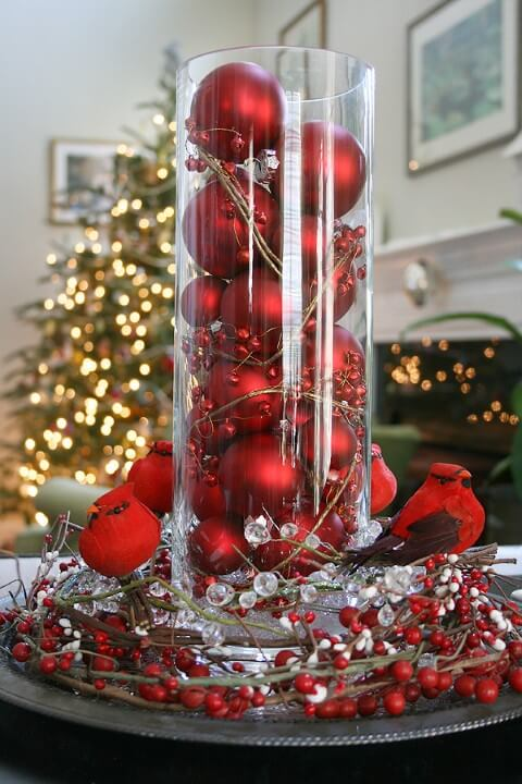 Red Christmas balls in table ornament Photo by The Happy Heathen