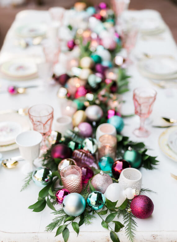 Christmas dinner table with colored Christmas balls Photo by Amara