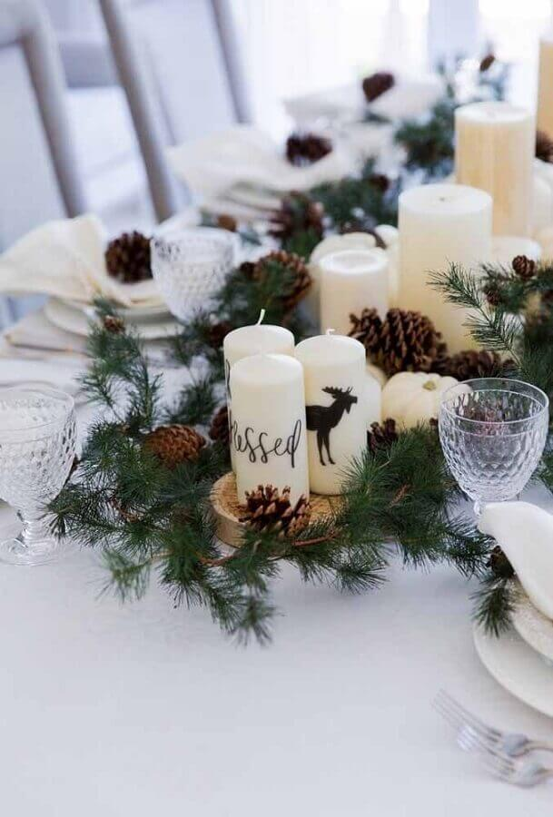 tips for christmas table decorations with candles and pinecones in wooden cookies Photo Fashionable Hostess