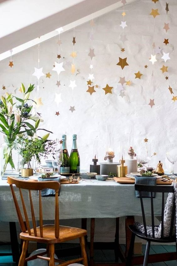 New Year's Eve Eve dinner with stars on the dining table
