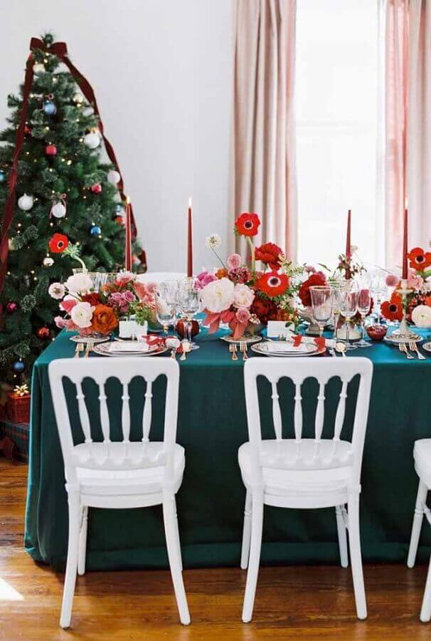 Christmas table decorated with large flower arrangements Christmas Glitter Photo