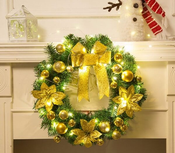 Christmas wreath made with artificial flowers and gold details