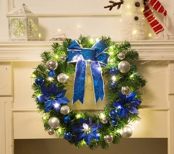 Christmas wreath made with artificial flowers and details in blue