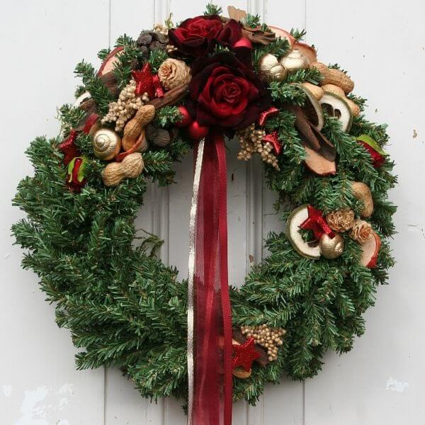 Wreath for Christmas with lace and artificial flowers