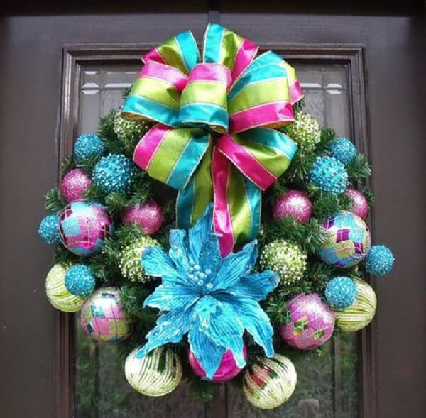 Christmas wreath with large ribbon bow and colored balls