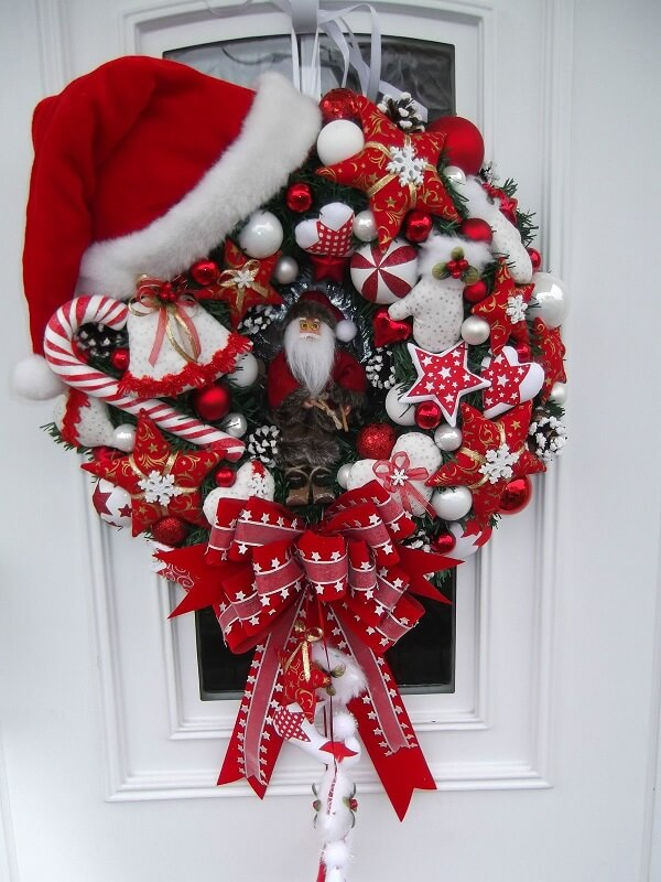 Christmas wreath in shades of red with Santa Claus