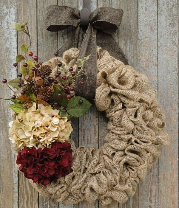 Wreath for Christmas with jute fabric and artificial flowers