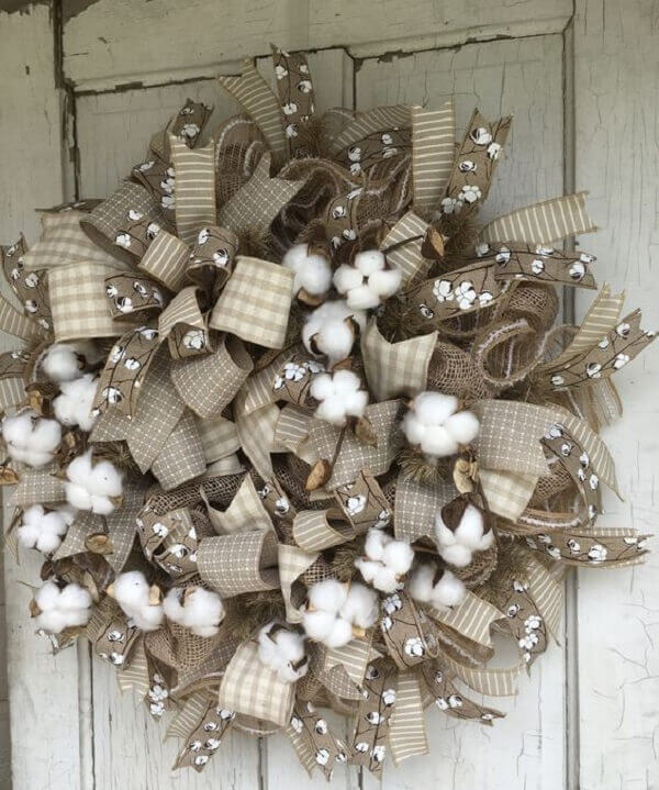 Wreath for Christmas with jute fabric and artificial flowers for rustic decoration
