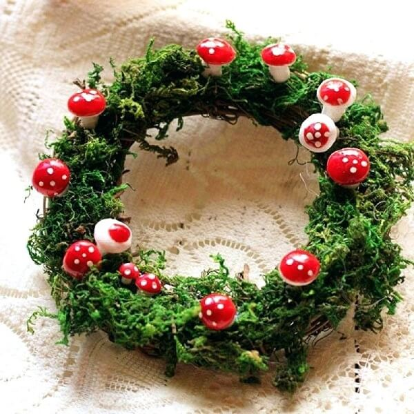 Christmas wreath made with artificial flowers and mushrooms