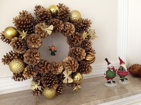 Christmas garland made with pinecones and golden balls