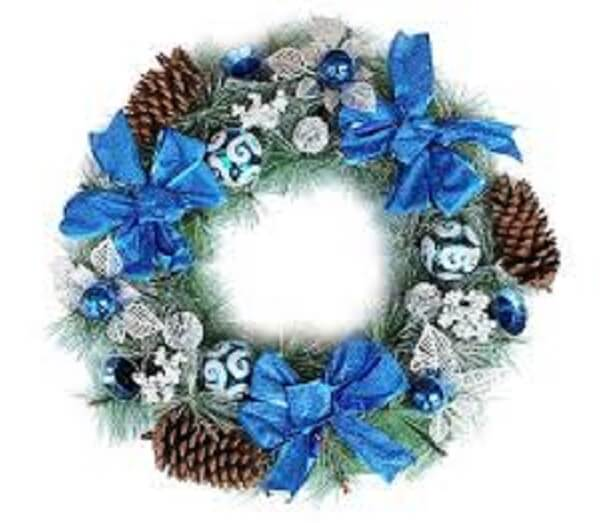 Christmas wreath made with pinecones and bows in blue tone