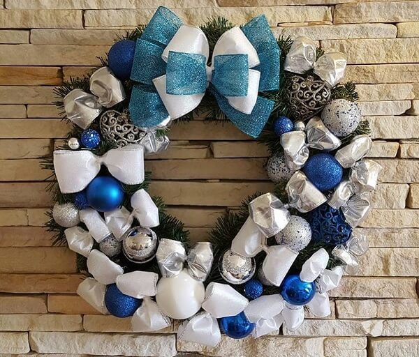 Christmas wreath in shades of white, blue and silver