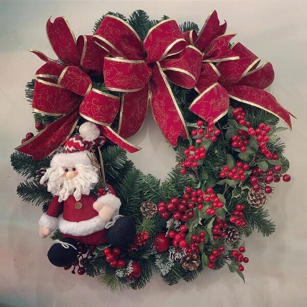Christmas wreath with bow and Santa Claus