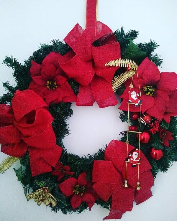 Christmas wreath with artificial flowers