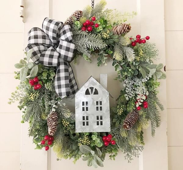 Christmas wreath with artificial flowers and printed bow