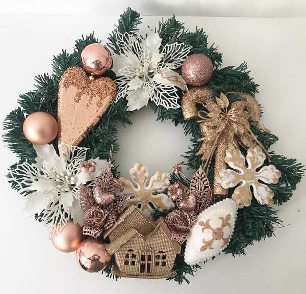Christmas wreath made with balls and artificial flowers