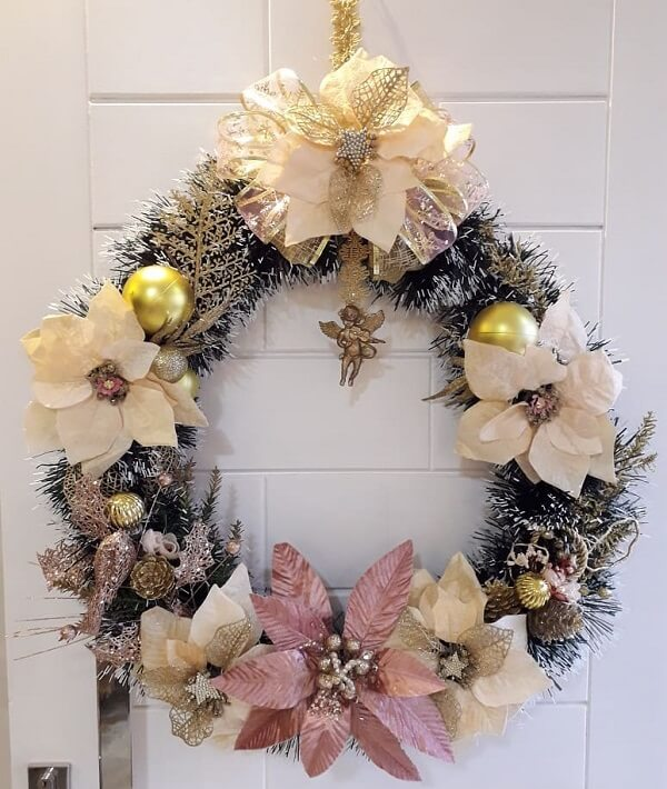 Christmas wreath with bows and angel