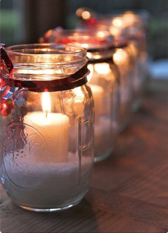 Glass jars can house candles and form beautiful Christmas decorations
