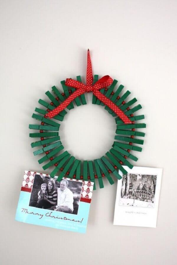 Christmas craft with garland of nails painted in green color