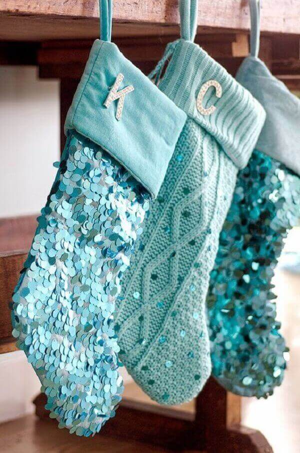 Christmas crafts hanging and glued stockings with sequins