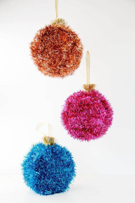 Cute and colorful pompoms of christmas crafts