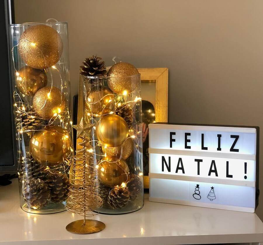 ornaments with Christmas pinecone and golden balls in glass vase Photo Our Ap 205