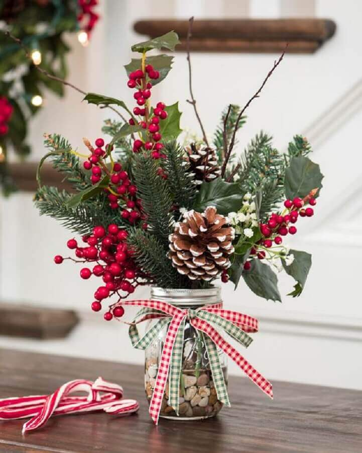 Christmas arrangement with pinecones and small red flowers Christmas Glitter Photo