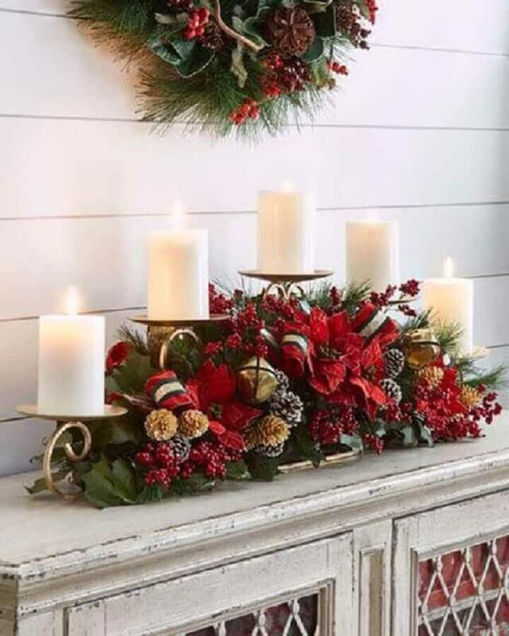 Christmas arrangement with pinecones candles and red flowers Christmas Glitter Photo