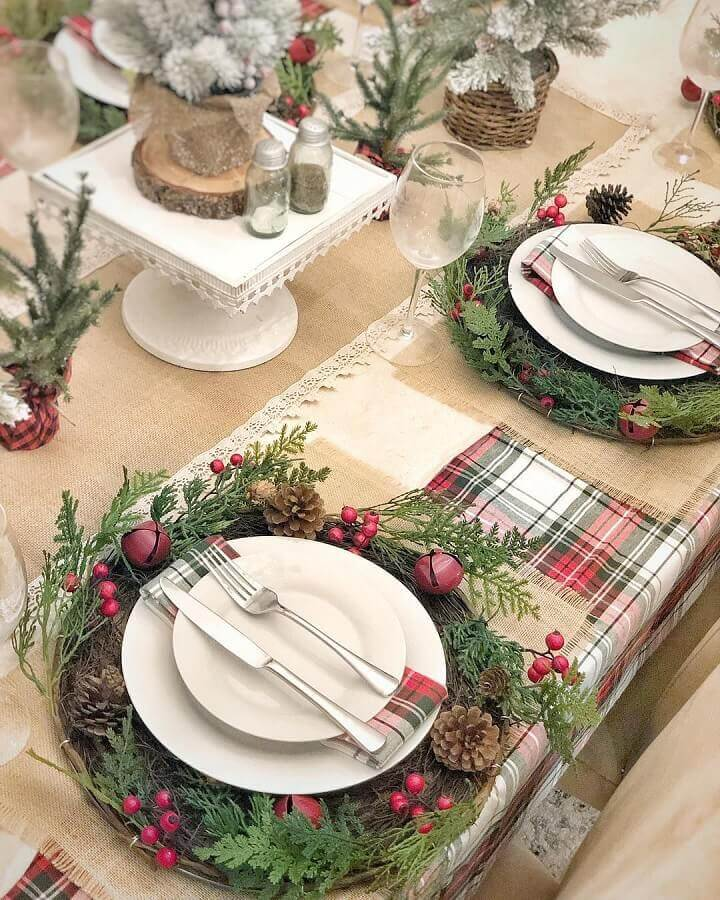 Christmas arrangements for table with pinecones and garland around plates with plaid napkins Photo Rustic & Woven
