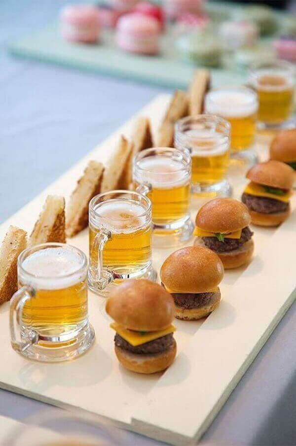 Party of barbecue burgers and beer mugs