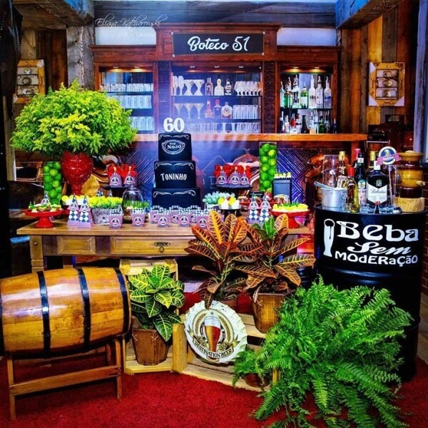 Wooden crates and lots of plants bring beauty to the bar party table