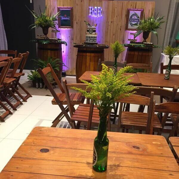 party boteco with tables decorated with flower arrangements