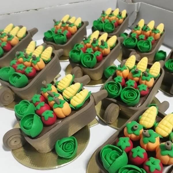 Sweets in the shape of cart full of vegetables makes the table even more special